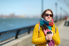 Beautiful young woman drinking coffee on sunny spring day Royalty Free Stock Photography