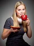 Beautiful young woman drinking coffee  or tea. Beautiful young woman drinking coffee over dark background Royalty Free Stock Images