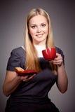Beautiful young woman drinking coffee  or tea. Beautiful young woman drinking coffee over dark background Stock Image