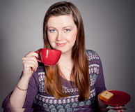 Beautiful young woman drinking coffee  or tea. Beautiful young  redhead woman drinking coffee Stock Photography
