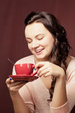 Beautiful young woman drinking coffee  or tea Stock Images