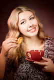 Beautiful young woman drinking coffee  or tea Royalty Free Stock Image