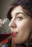 Beautiful Young Woman Drinking Glass of Cranberry Juice stock photos
