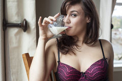 Beautiful Young Woman Drinking Glass of Milk stock images