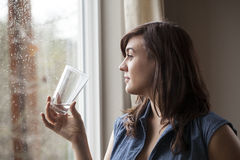 Beautiful Young Woman Drinking Glass of Water Stock Images