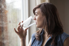 Beautiful Young Woman Drinking Glass of Water Royalty Free Stock Photography