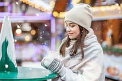 Beautiful Young Woman Drinking Hot Coffee On The Street. Concept Stock Photography