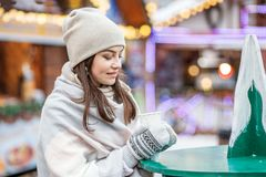 Beautiful Young Woman Drinking Hot Coffee On The Street. Concept Lifestyle, Urban, Winter, Vacation, Happy Christmas, New Year Stock Photography
