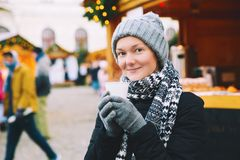 Woman drinking hot tea or mulled wine at Christmas in Europe Stock Image
