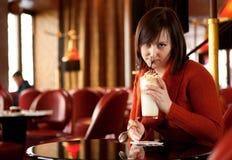Beautiful young woman drinking latte Stock Image