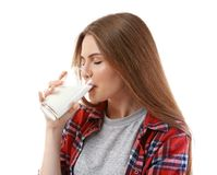 Beautiful young woman drinking milk. On white background Stock Images