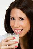 Beautiful young woman drinking milk Stock Photo