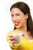 Beautiful young woman drinking milk Stock Image