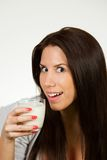 Beautiful young woman drinking milk Royalty Free Stock Photography