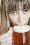 Young Woman Happy About Her Beer Stock Photography