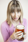 Young Woman Drinking Mug of Beer Stock Images