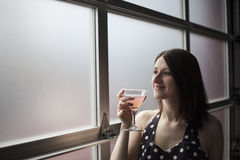 Beautiful Young Woman Drinking a Pink Martini Royalty Free Stock Photo