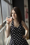 Beautiful Young Woman Drinking a Pink Martini Royalty Free Stock Images