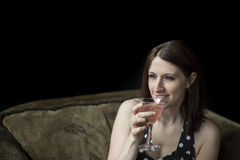 Beautiful Young Woman Drinking a Pink Martini Royalty Free Stock Photography