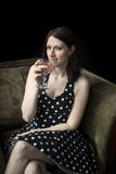 Beautiful Young Woman Drinking a Pink Martini Stock Photos