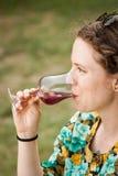 Beautiful young woman drinking sangria Stock Photos