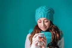 Beautiful young woman drinking tea Stock Photos