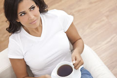 Beautiful Young Woman Drinking Tea or Coffee Stock Photos