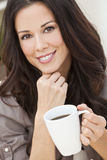 Beautiful Young Woman Drinking Tea or Coffee Royalty Free Stock Photo