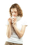 Beautiful young woman drinking tea/coffee Royalty Free Stock Photography