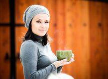 Beautiful young woman drinking tea Royalty Free Stock Images