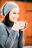 Beautiful young woman drinking tea Royalty Free Stock Photos