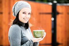 Beautiful young woman drinking tea Stock Images
