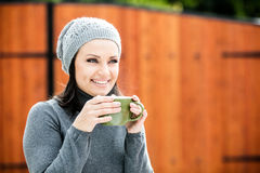 Beautiful young woman drinking tea Stock Photography