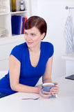 Beautiful young woman drinking tea at home Royalty Free Stock Image