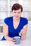 Beautiful young woman drinking tea at home Stock Photos