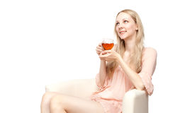 Beautiful young woman drinking tea sitting Royalty Free Stock Images