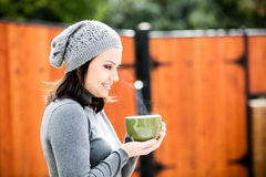 Beautiful young woman drinking tea Royalty Free Stock Image