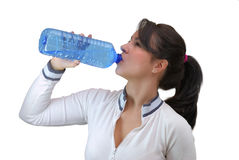 Beautiful young woman drinking water Stock Images