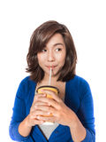 Beautiful young  woman drinking in yellow paper cup with straw o Royalty Free Stock Photos