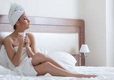 Beautiful young woman drinks coffee after shower Stock Photography