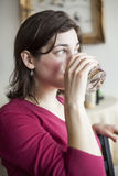 Beautiful Young Woman Drinks a Glass of Water Royalty Free Stock Photography