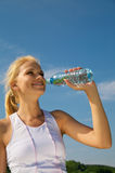 Beautiful young woman drinks water Royalty Free Stock Image