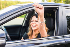 Beautiful young woman driver showing car keys in hand.  Stock Images