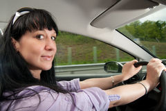 Beautiful young woman drives a car Royalty Free Stock Photos