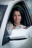 Beautiful young woman driving a car Royalty Free Stock Images