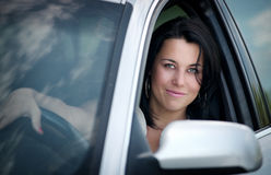 Beautiful young woman driving a car royalty free stock photos