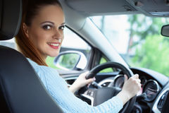 Beautiful young woman driving a car Stock Photography