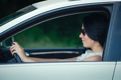 Beautiful young woman driving a car Stock Photos