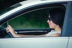 Beautiful young woman driving a car Stock Photos
