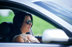 Beautiful young woman driving a car Royalty Free Stock Image